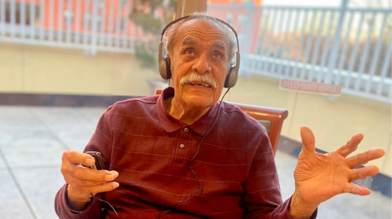 Elderly man listening to music with headphones